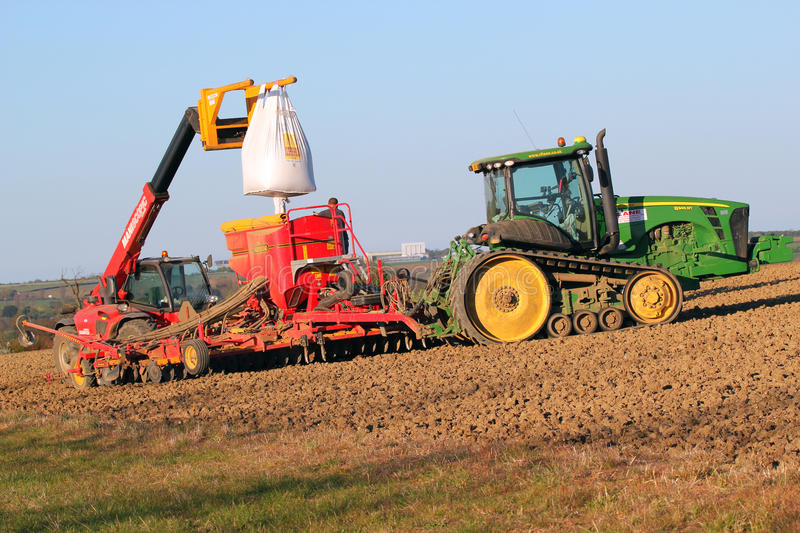Filling a seed drill with new corn. stock photos