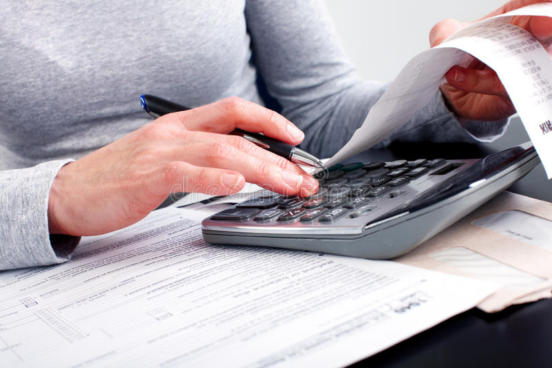 Filling the Tax Form stock images