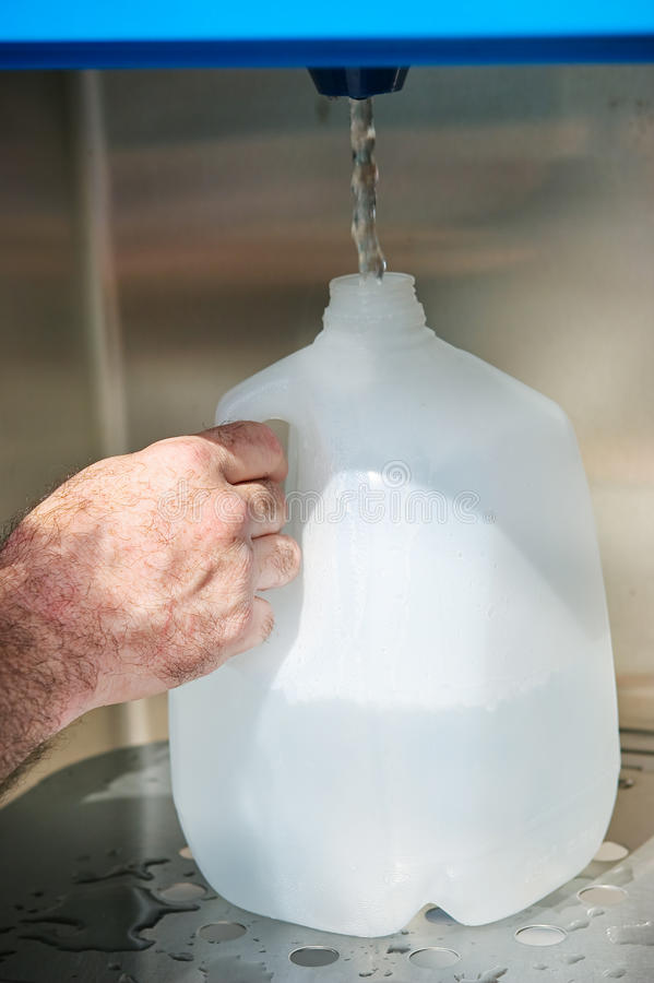 Filling Water Jug stock photography