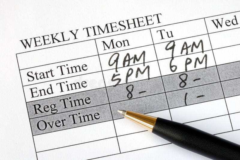 Filling the weekly time sheet. For payroll stock photo