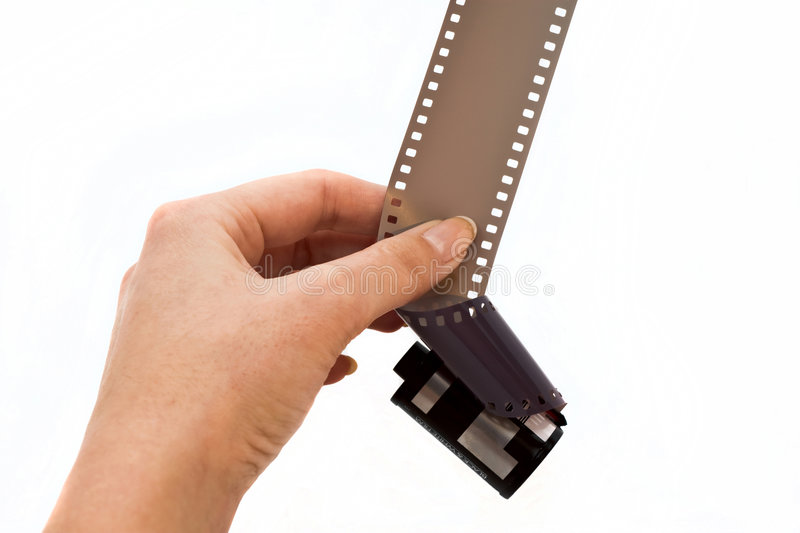 Film. Famale hand deems roll of film his hand royalty free stock images
