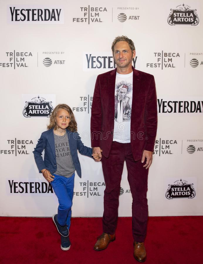 Josh Lucas at World Premiere of `Yesterday` at 2019 Tribeca Film Festival. Film actor Josh Lucas arrives with his son, Noah Rev Maurer, in tow at the World royalty free stock photography