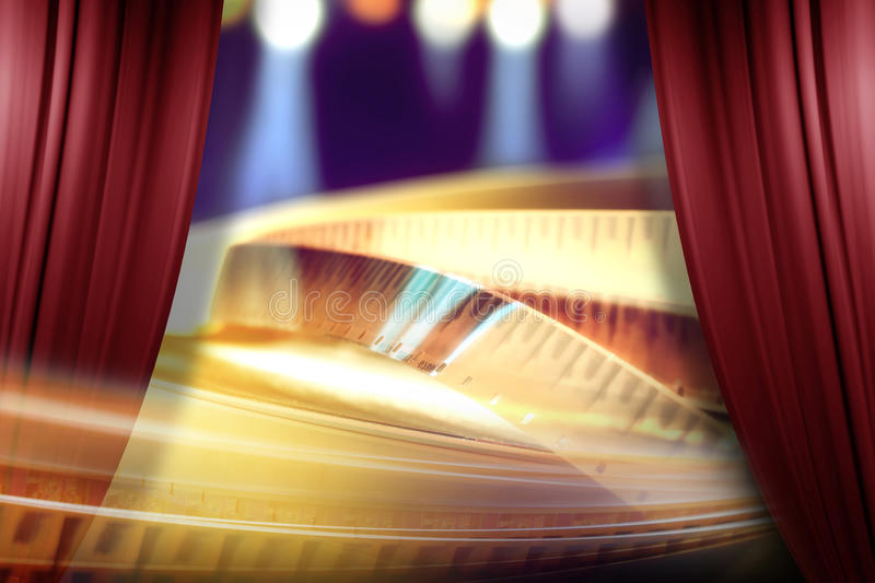 Film award on the spotlight background. Behind of open red curtain stock photo