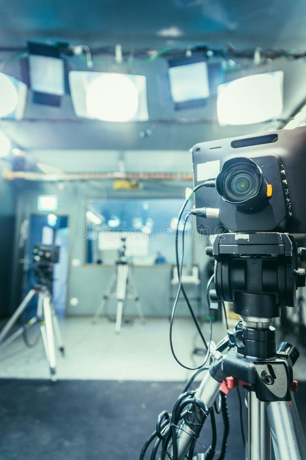 Film camera in broadcasting studio, spotlights and other equipment royalty free stock image