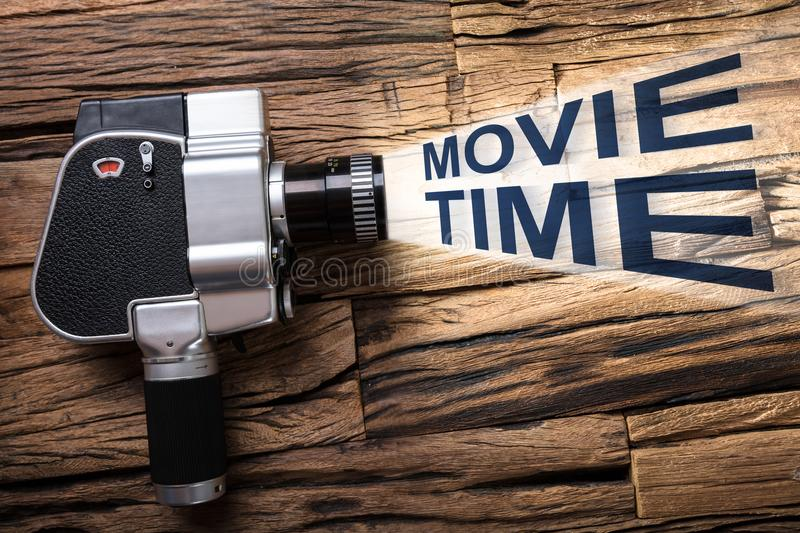 Film Camera Emitting Light With Text Movie Time stock images
