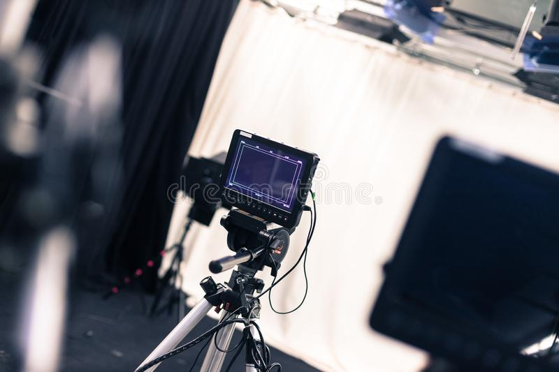 Professional film camera with lcd screen on a tripod in broadcasting studio stock photo