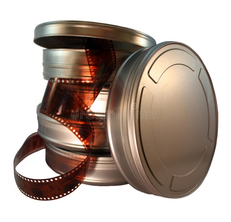 Film canisters. Five movie canisters one with film reeling out stock images