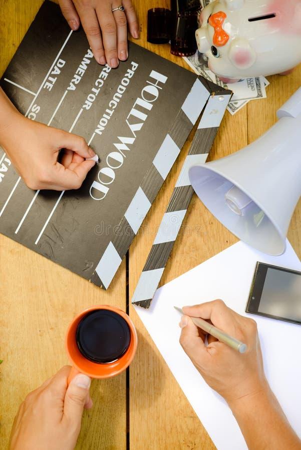 Film che fa con il ciac, megafono e fotografia stock