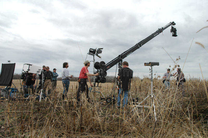 Film crew makinga movie. Film crew with crane and HD camera making a movie. lights camera action on the set stock photo
