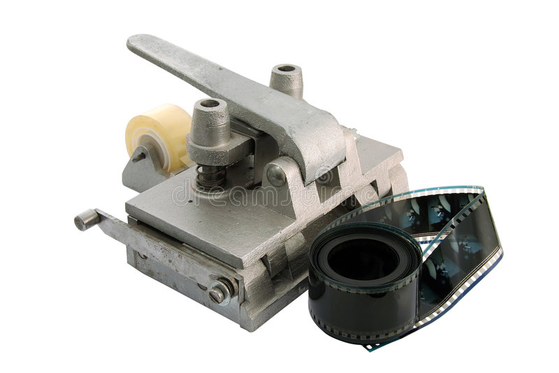 Film cutting tool. Old film cutting and pasting tool, used in small cinemas stock photo