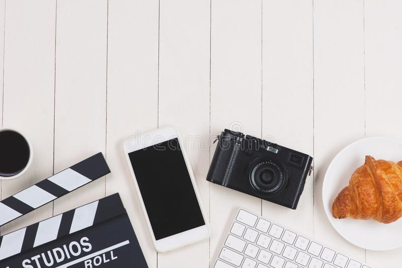 Film director desk with movie clapper board. Top view. royalty free stock image