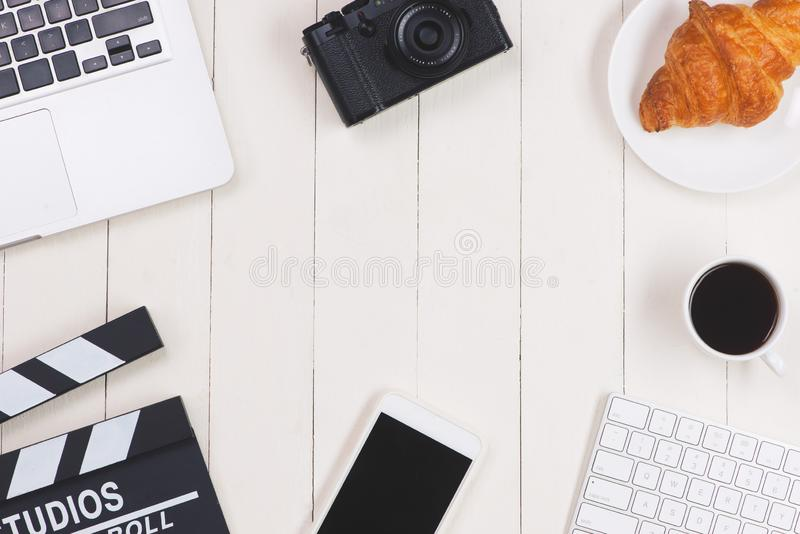 Film director desk with movie clapper board. Top view royalty free stock image