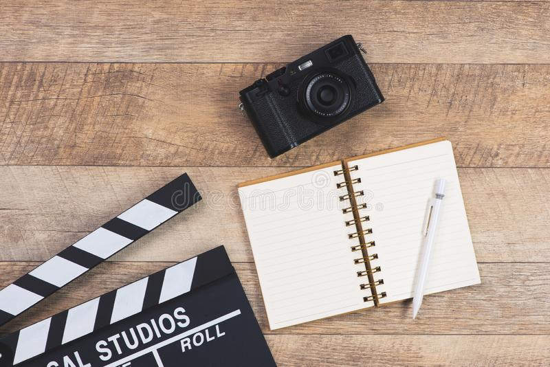 Film director desk with movie clapper board. Top view royalty free stock photo