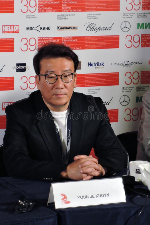 Film director and producer Youn Je Kuoyn. MOSCOW - JUNE 25, 2017: Film director and producer Youn Je Kuoyn South Korea gives a press-conference at 39th Moscow royalty free stock photography