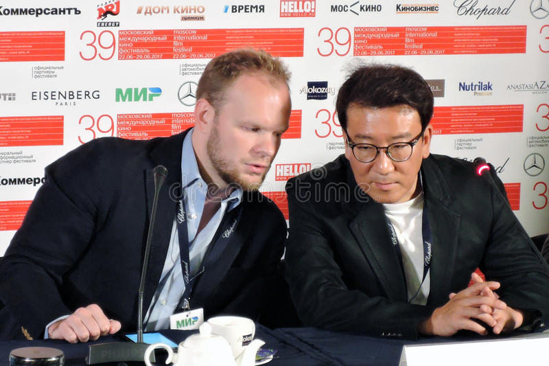 Film director and producer Youn Je Kuoyn at right. MOSCOW - JUNE 25, 2017: Film director and producer Youn Je Kuoyn South Korea gives a press-conference at 39th royalty free stock photo