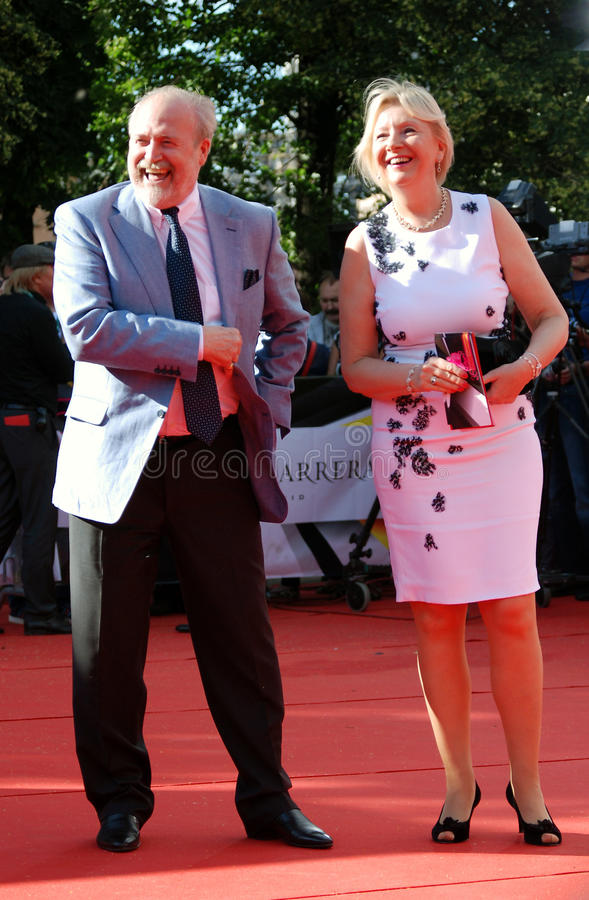 Film director Vladimir Khotinenko with his wife. At XXXV Moscow International Film Festival red carpet opening ceremony. They smile and pose for photos. Taken royalty free stock image