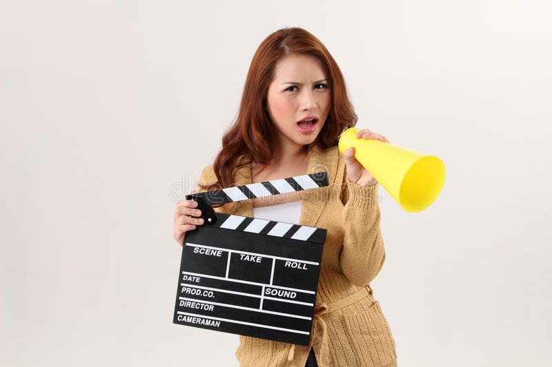 Film director. Woman holding film slate and bullhorn royalty free stock images