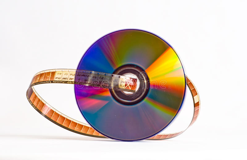 Film - DVD. Film reeled up between the disks, on white background royalty free stock photography