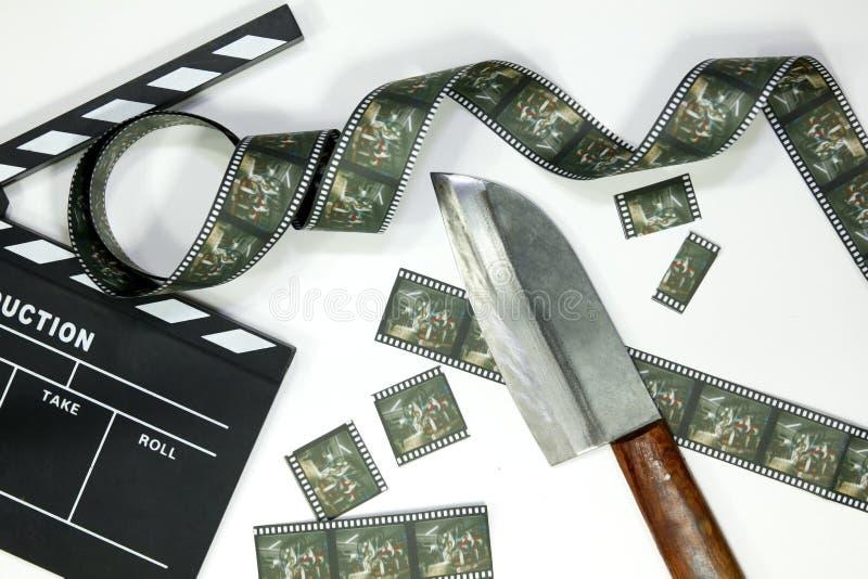 Film en clapperboard op witte achtergrond, het uitgeven het concept van de filmmaker, voor redacteur en directeur stock foto's