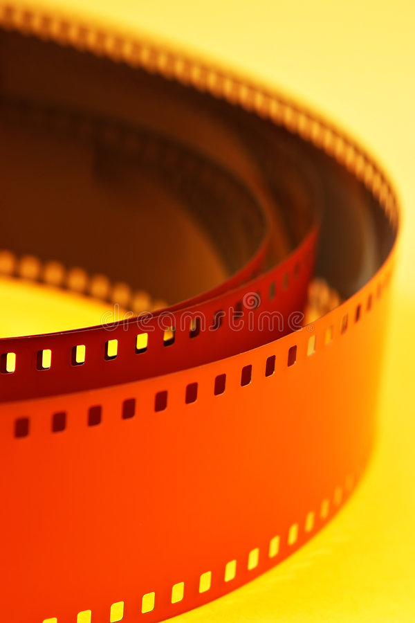 Film negative. On yellow background royalty free stock photos