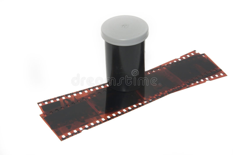 Film and Negatives over white. Canister and negatives over white royalty free stock image