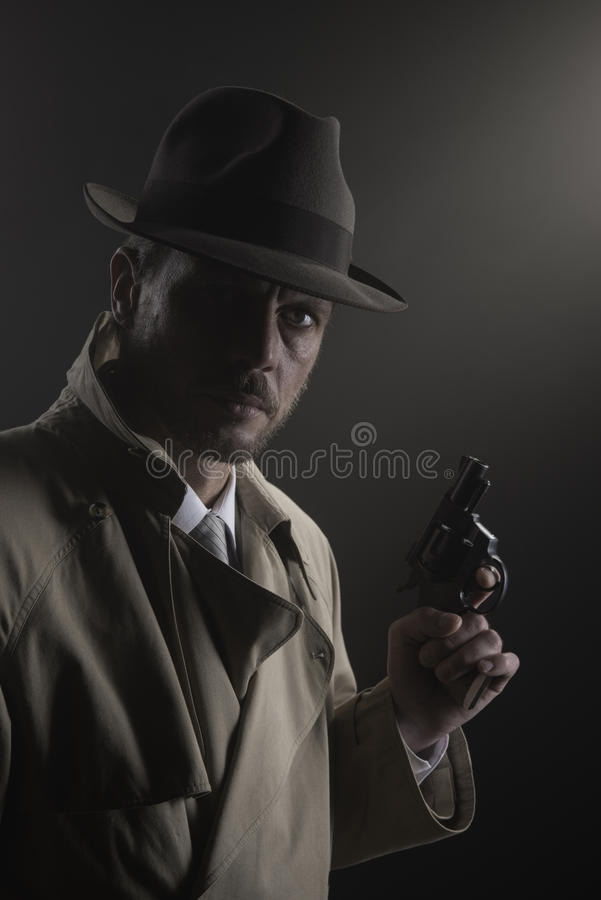 Film noir: detective in the dark with a gun stock images