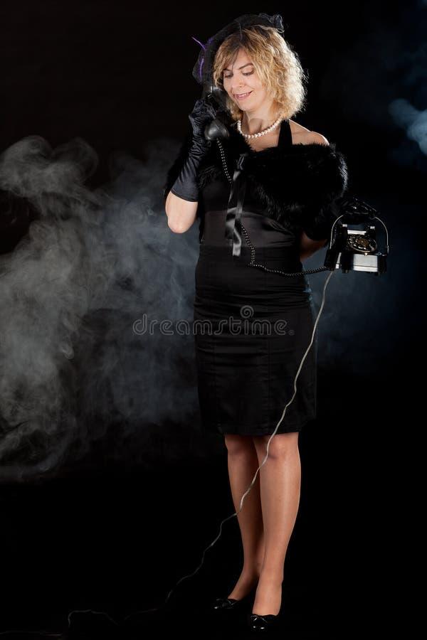 Film noir girl telephone stock images