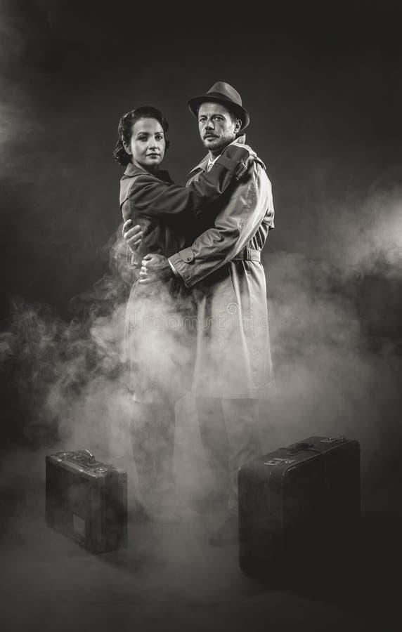 Film Noir Romantic Loving Couple Embracing In The Dark 1950s Style