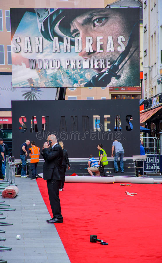 Film Premier - San Andreas. A picture of people preparing the set outside the Odeon cinema in Leicester Square London for the world premier of the San Andreas royalty free stock photos
