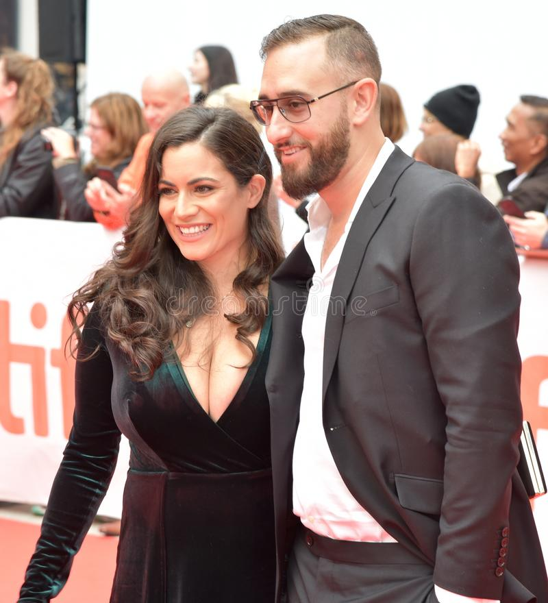 Film producer of `The Public` at Toronto International Film Festival 2018. Producer of the `The Public`, along with his date, at Toronto International Film royalty free stock photo