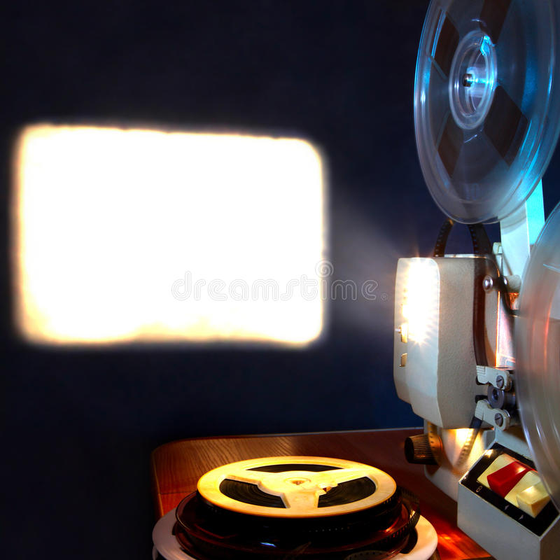 Film Projector. Old film projector show the film in dusk onto a wall royalty free stock photography