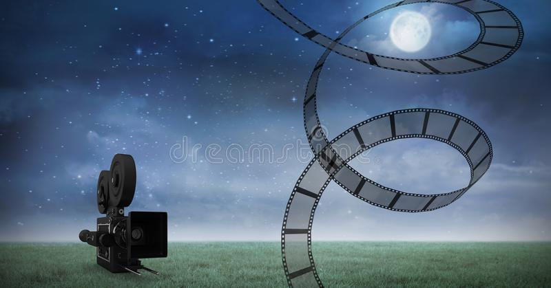 Film reel against video camera and night sky in background stock photos
