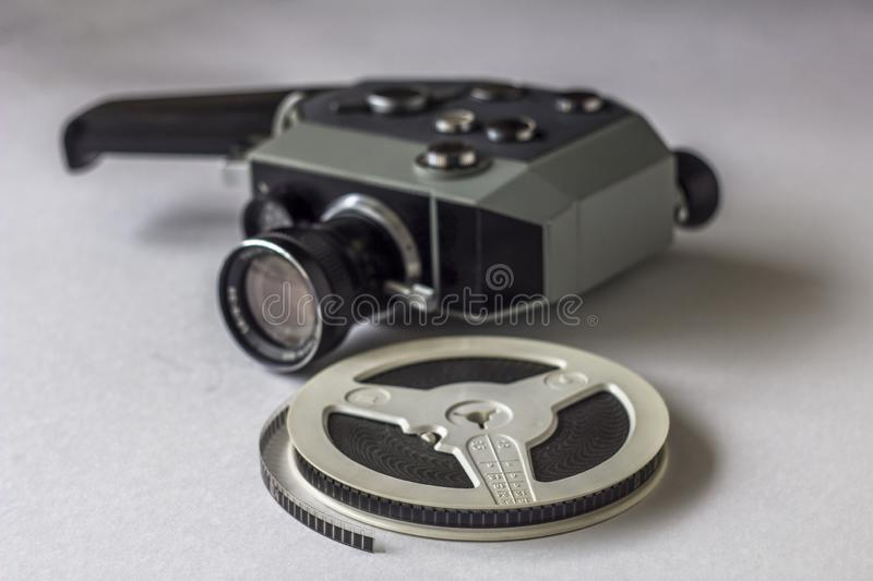 Film reel on blurry background of a vintage mechanical video camera stock photography