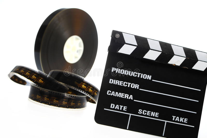 Film reel and cinema clap. A black film case reel and a cinema clap isolated on white stock photography