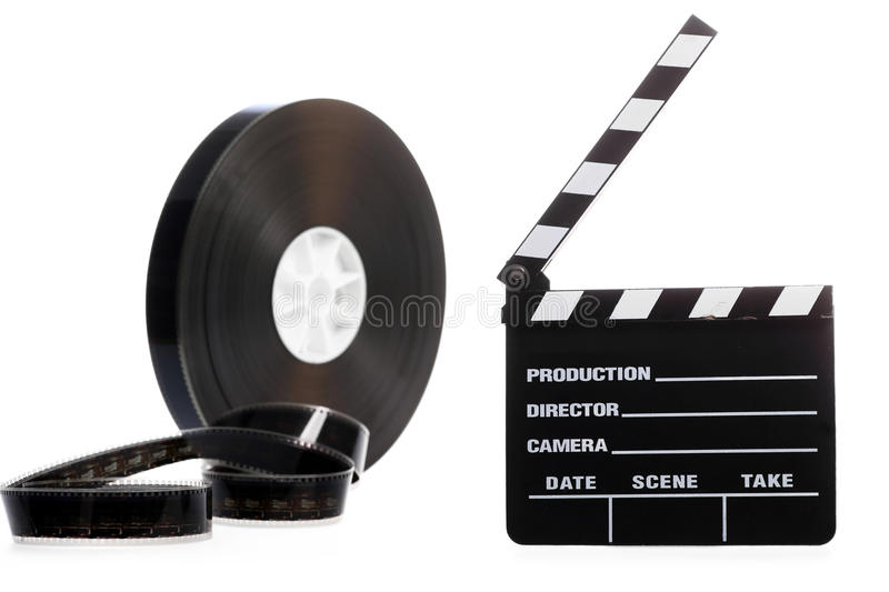 Film reel and cinema clap. A black film case reel and a cinema clap isolated on white royalty free stock photography
