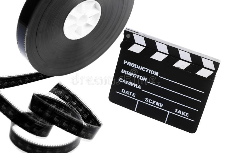 Film reel and cinema clap. A black film case reel and a cinema clap isolated on white royalty free stock images