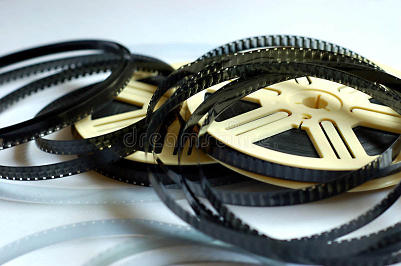 Film reels on white background. Actor actress art can canister cinema cinematic develop director edit editor entertainment film filmstrip flash flick focus stock photography