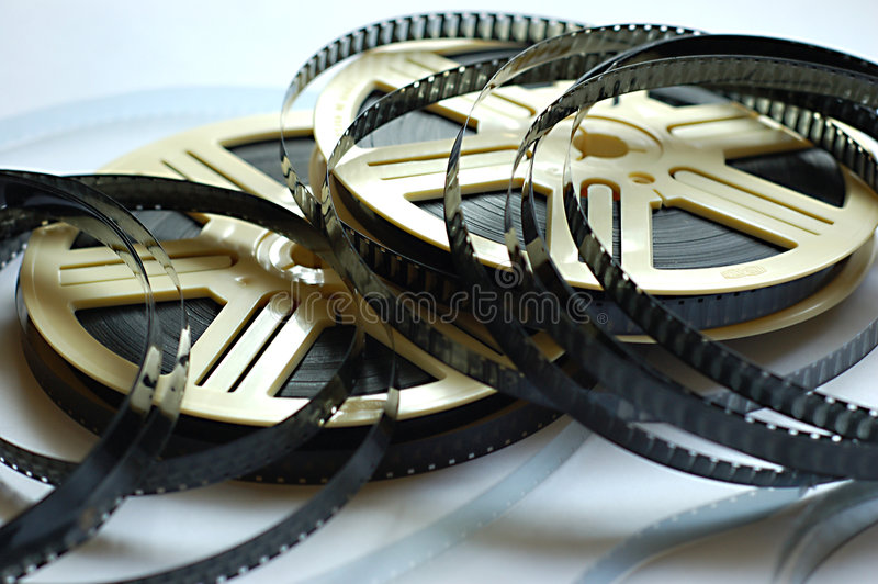 Film reels on white background. Actor actress art can canister cinema cinematic develop director edit editor entertainment film filmstrip flash flick focus royalty free stock photography