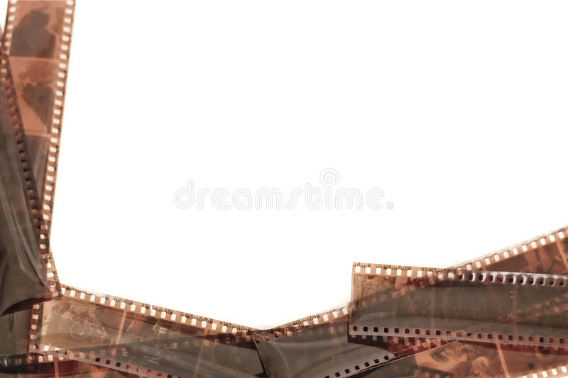 Film roll analog camera isolated. Film roll analog camera and negatives isolated on white background stock photography