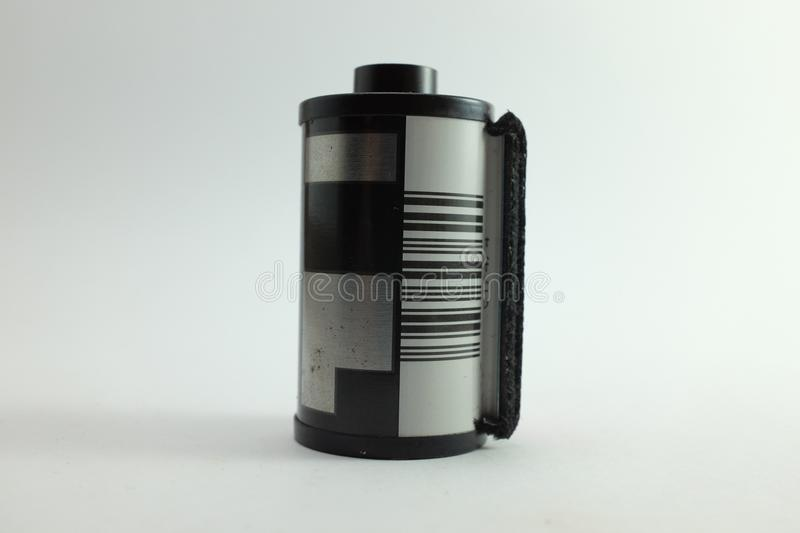 Film roll in cartridge on isolated white background stock photo
