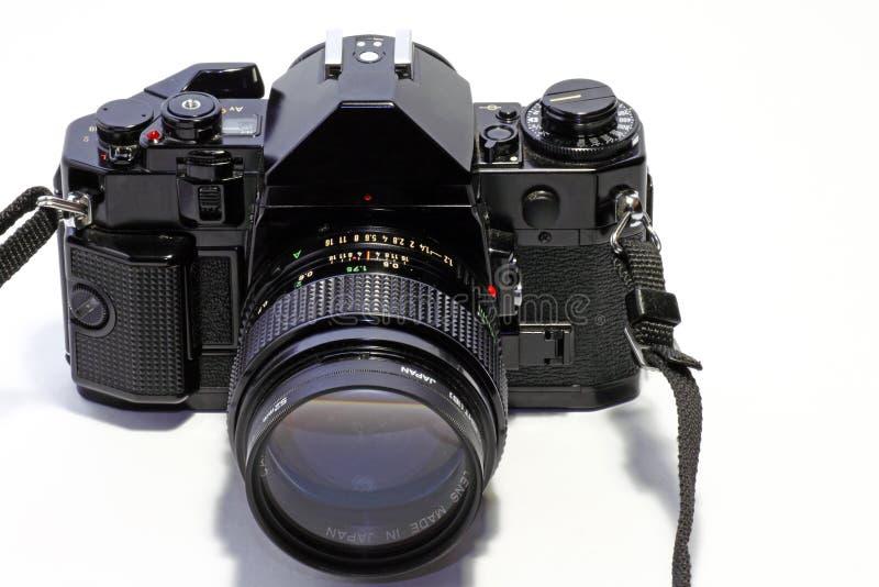 Film SLR camera. A frontal image of a full frame film SLR camera stock photo