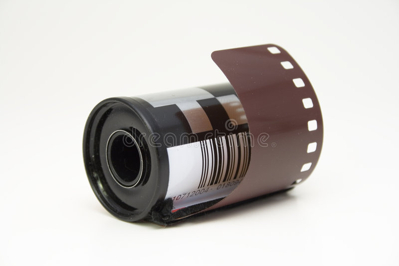 Film strip in roll. Camera film strip in roll royalty free stock image