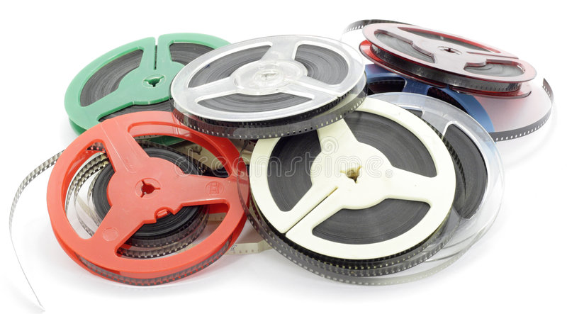 Film1. Old house 8 mm films on multi-coloured coils royalty free stock photo