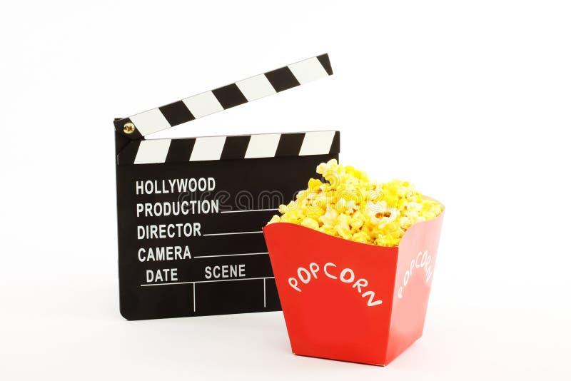 Filmclapper och popkorn arkivbild