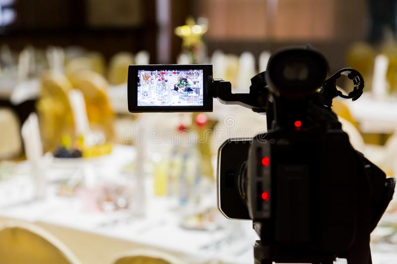 Filming of the event. Videography. Served tables in the Banquet hall.  stock images
