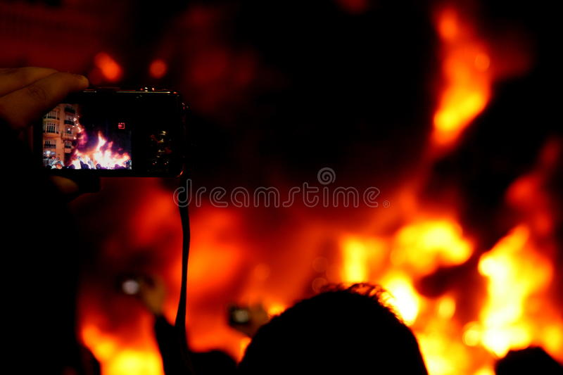 Filming the fire stock images