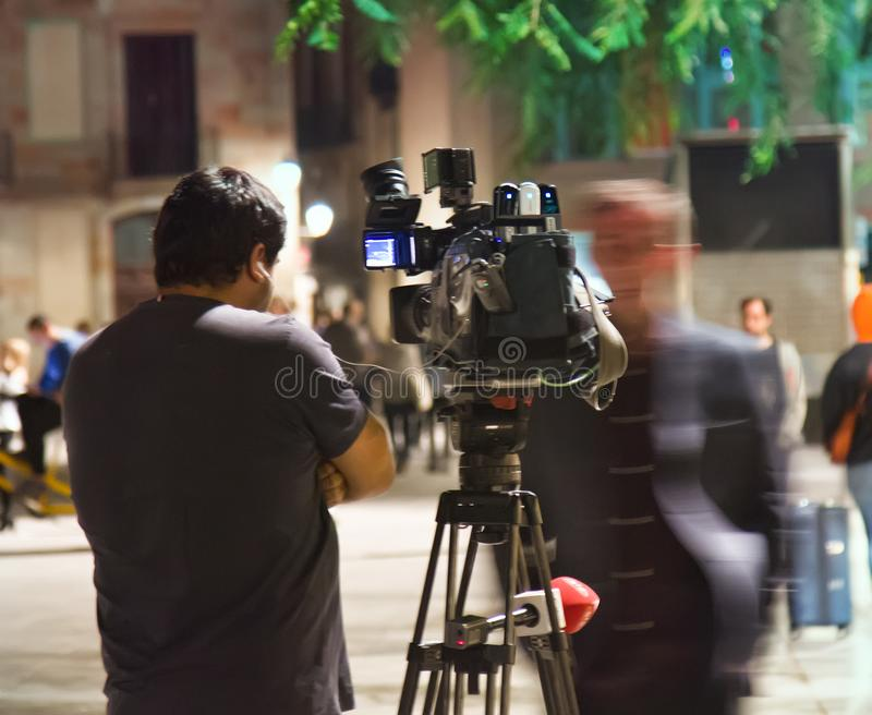 Filming Work of operator on street at night royalty free stock photography