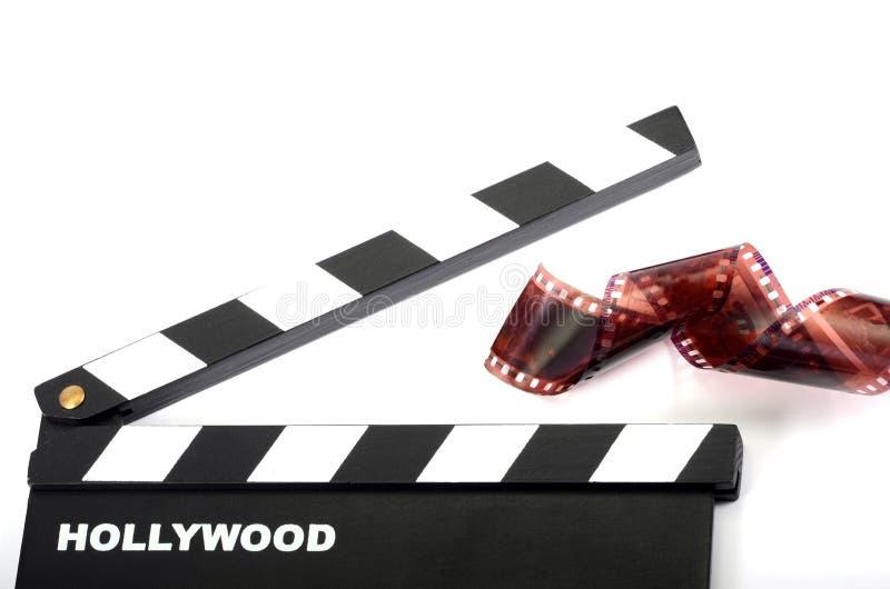Filmscharnierventilbrett und Filmstreifen lokalisiert lizenzfreie stockbilder