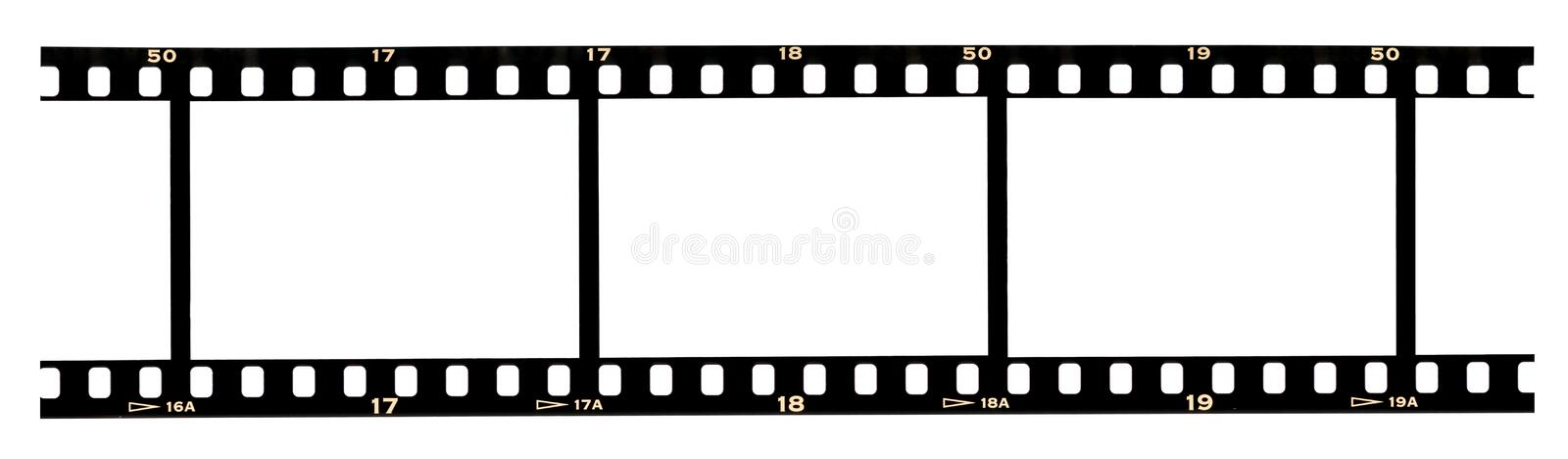 Filmstrip frames. Scanned slide filmstrip with blank space in frames and numbers near perforation stock photography
