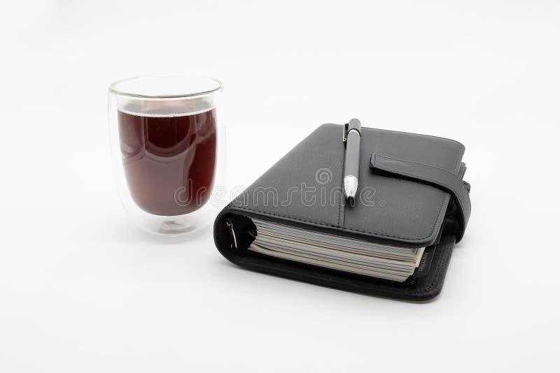 Filofax i kawa odizolowywaj?cy na bia?ym tle, zdjęcia stock